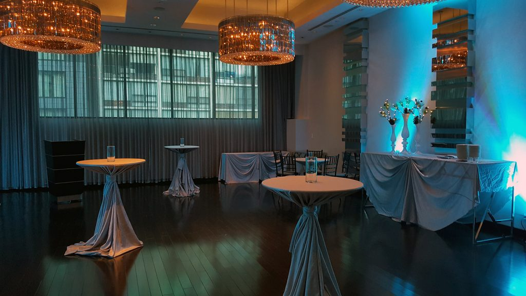 wedding reception with cocktail tables in Ivy hotel event space