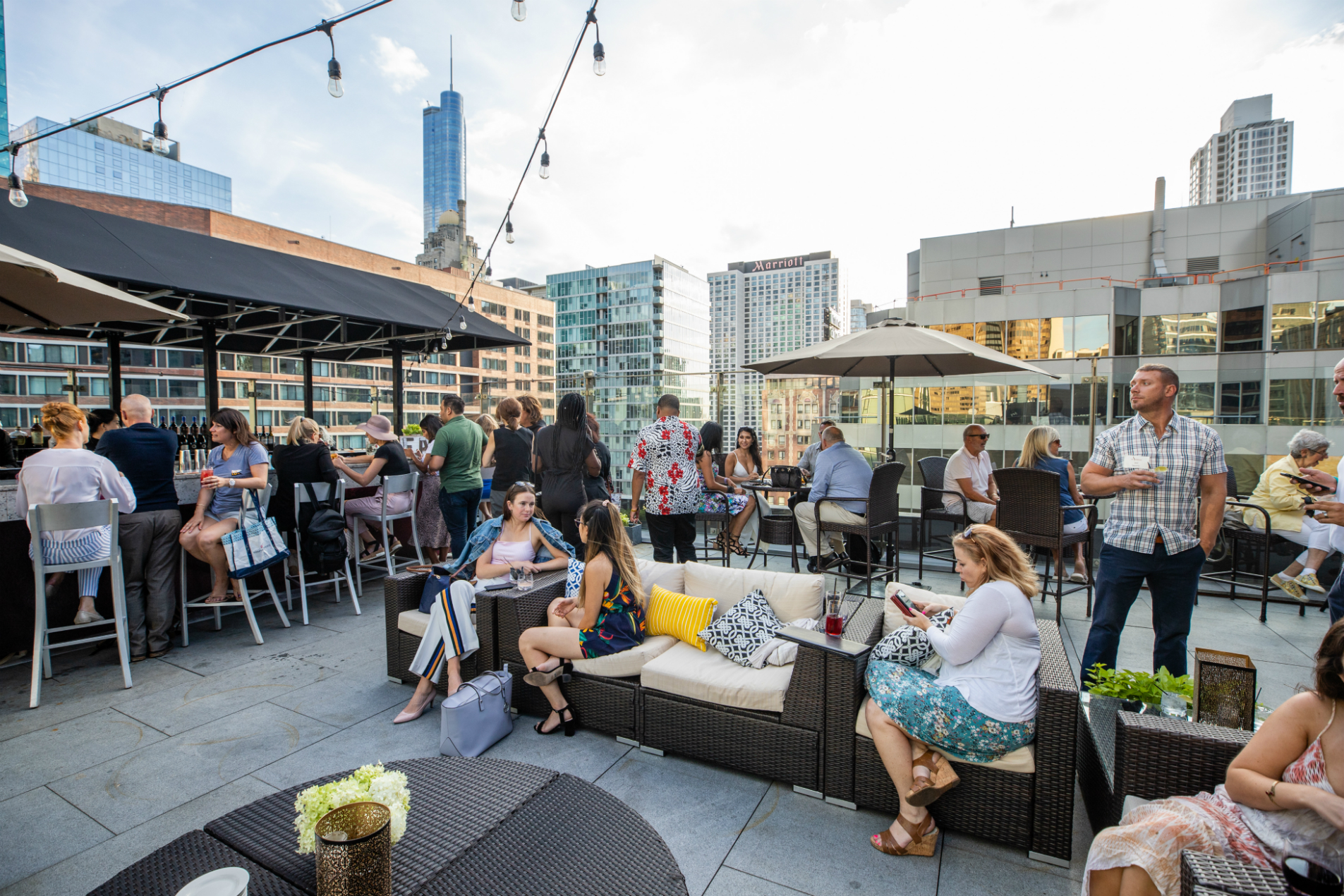 patrons at ivy hotel's private rooftop bar in downtown Chicago