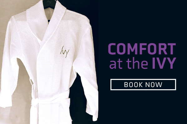 ivy hotel bathrobe featuring text that reads: comfort at the ivy. book now.