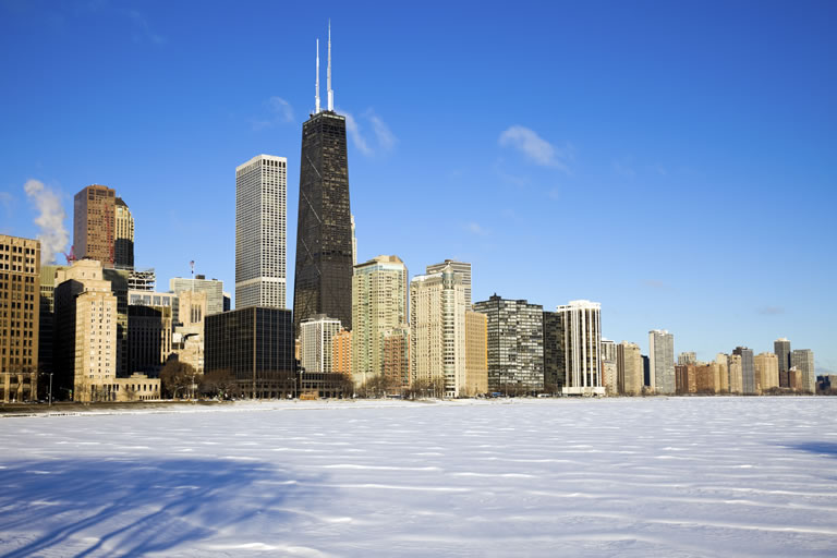 Chicago city skyline with frozen Lake Michigan